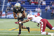 Annapolis, MD - December 27, 2016: Wake Forest Demon Deacons wide receiver Scotty Washington (7) gets tackled by Temple Owls defensive back Delvon Randall (23) during game between Temple and Wake Forest at  Navy-Marine Corps Memorial Stadium in Annapolis, MD.   (Photo by Elliott Brown/Media Images International)