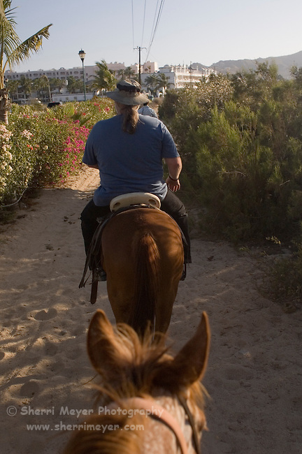 Tourists horseback riding in Cabo San Lucas, Baja California, Mexico