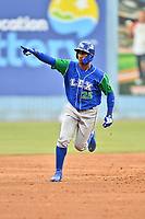 Lexington Legends right fielder Seuly Matias (25) rounds the bases after hitting a home run during a game against the Asheville Tourists at McCormick Field on May 25, 2018 in Asheville, North Carolina. The Tourists defeated the Legends 6-4. (Tony Farlow/Four Seam Images)