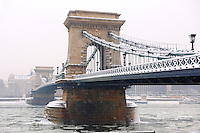 South  side of the Szechenyi lánchíd (Chain Bridge) in the winter snow looking towards the castle district. Budapest Hungary stock photos.