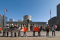 Pro-Life advocates display signs as they stand on the sidewalk at a rally at the Statehouse in Columbus, Ohio, Monday, Nov. 23, 2006 on the 33rd anniversary of the Supreme Court Roe v. Wade decision.<br />