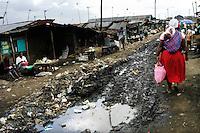 Nairobi .Una strada dello slum di Korogocho alla periferia di Nairobi    ..Nairobi: people in the street in the Korogocho slum