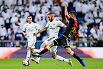 Karim Benzema of Real Madrid (L) is tackled by Emiliano Daniel Velazquez Maldonado, E Velazquez, of Rayo Vallecano during the La Liga 2018-19 match between Real Madrid and Rayo Vallencano at Estadio Santiago Bernabeu on December 15 2018 in Madrid, Spain. Photo by Diego Souto / Power Sport Images