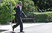 United States President Barack Obama waves to the press pool as he departs the White House in Washington, DC en route to Joint Base Andrews where he will fly to New Brunswick, New Jersey to deliver a commencement speech at Rutgers University on May 15, 2016.<br /> Credit: Dennis Brack / Pool via CNP