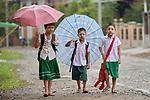 Children walk home from school in Kalay, a town in Myanmar.
