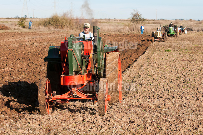 Antique tractors plowing a field in fall during the Branch 158 EDGE & TA Fall Plow Day and Plowing Seminar near Pleasant Grove, Calif...Silmer Scheidel Farm..Jeff Wasllom's 1927 Eagle Mod. H Tractor, 16-30 hp