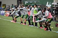 PORTLAND, OR - MARCH 01: Diego Valeri #8 and the Portland Timbers starting line up stretch during warm ups during a game between Minnesota United FC and Portland Timbers at Providence Park on March 01, 2020 in Portland, Oregon.