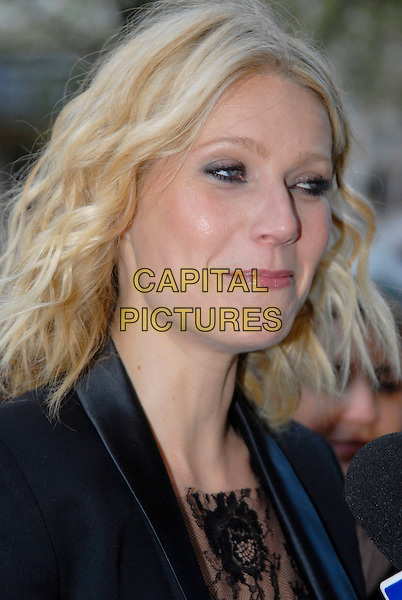 """GWYNETH PALTROW .UK Premiere of """"Iron Man"""" at the Odeon, Leicester Square, London, England, April 24th 2008..portrait headshot being interviewed microphone funny face .CAP/ROS .©Steve Ross/Capital Pictures"""