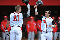 Rutgers University Scarlet Knights infielder Nick Favatella (5) celebrates a home run with team mate Brian O'Grady (21) during game game 1 of a double header against the University of Houston Cougers at Bainton Field on April 5, 2014 in Piscataway, New Jersey. Rutgers defeated Houston 7-3.      <br />  (Tomasso DeRosa/ Four Seam Images)