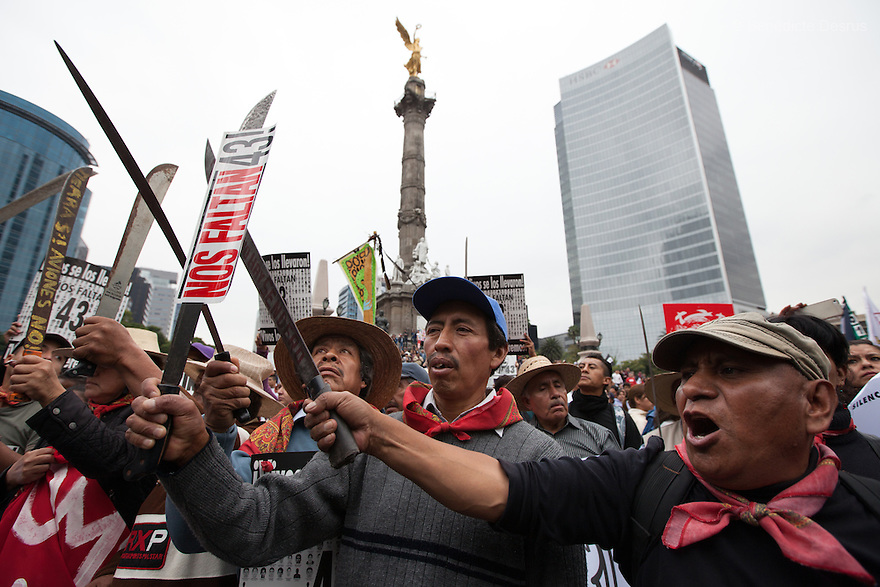 People of San Salvador Atenco take part to a march to mark the one-year anniversary of the disappearance of the 43 students from Mexico's Ayotzinapa College Raul Isidro Burgos, in Mexico City, Mexico on September 26, 2015. Families of the missing and international experts cast doubt on Mexican government's official account of the incident: that municipal police handed the students over to a local drug gang who burned their bodies in a nearby garbage dump. The families asked the government to launch a new internationally supervised investigation and to review Mexico's own investigators. More than 25,000 people have disappeared in Mexico since 2007, according to the government. (Photo by Bénédicte Desrus)