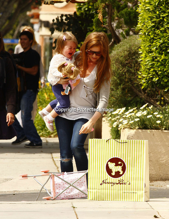 4-24-09.Isla Fisher shopping with her baby Olive at a kids store called Jenny Bec's in Los Angeles ca. Then they went to Café Lux the  Poor little Olive was crying  THEN ISLA HAD TO TALK HER WAY OUT OF A PARKING TICKET..AbilityFilms@yahoo.com.805-427-3519.www.AbilityFilms.com.