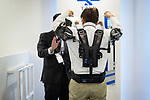 A visitor tries an exoskeleton designed to help worker in warehouse environment or airport at an robot exhibition Robodex in Tokyo on January 17, 2019. Some 220 robot companies display their recent products and technlogies at a three-day exhibition. January 17, 2019 (Photo by Nicolas Datiche/AFLO) (JAPAN)