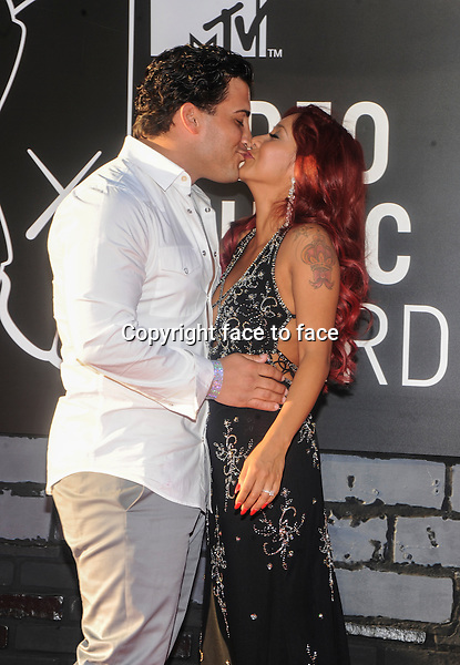 BROOKLYN, NY - AUGUST 25: Snooki and Jionni LaValle attending the 2013 MTV Video Music Awards at The Barclays Center in Brooklyn, NY on August 25, 2013. <br />