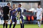Coca-Cola Football League Championship - Swansea City v Cardiff City @ The Liberty Stadium in Swansea..Cardiff's Michael Chopra (middle) and Wayne Routledge complaining to referee Martin Atkinson..