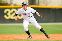 Forrest Brandt (10) of the Davidson Wildcats takes his lead off of first base against the Western Carolina Catamounts at Wilson Field on March 10, 2013 in Davidson, North Carolina.  The Catamounts defeated the Wildcats 5-2.  (Brian Westerholt/Four Seam Images)