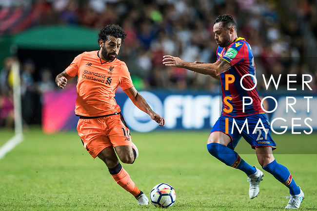 Liverpool FC forward Mohamed Salah (L) fights for the ball with Crystal Palace defender Damien Delaney (R) during the Premier League Asia Trophy match between Liverpool FC and Crystal Palace FC at Hong Kong Stadium on 19 July 2017, in Hong Kong, China. Photo by Yu Chun Christopher Wong / Power Sport Images