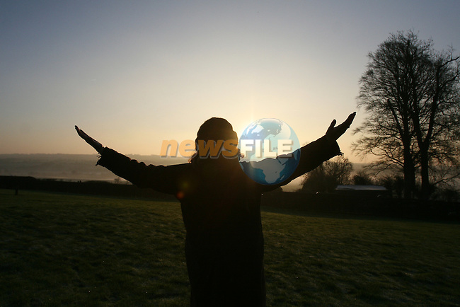 The winter solstice at newgrange in Co Meath, where the sun shines through a roof box to light up the burial chamber. Karen Ward and John Cantwell  from smithfield in Dublin celebrate the dawn of a new year at newgrange.Photo: Newsfile/Fran Caffrey.