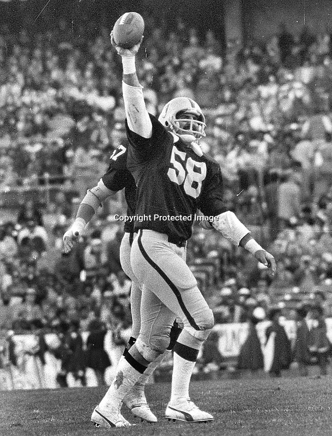 Raider Monte Johnson celebrates interception (1977 photo/Ron Riesterer)