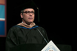 Jason Beck, assistant dean, serves as the university marshal Saturday, June 10, 2017, during the DePaul University School of Music and The Theatre School commencement ceremony at the Rosemont Theatre in Rosemont, IL. (DePaul University/Jeff Carrion)