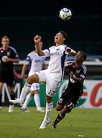 Thabiso Khumalo (17) of D.C. United fights for the ball with Roger Espinoza (17) of the Kansas City Wizards at RFK Stadium in Washington, DC.  D.C. United defeated the Kansas City Wizards, 2-1.