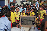 May 23, 2013: Ocean Beach, San Diego, California, USA:  Junior Lifeguards stand with the statue and after the San Diego Lifeguard Bronze Memorial Dedication Ceremony.