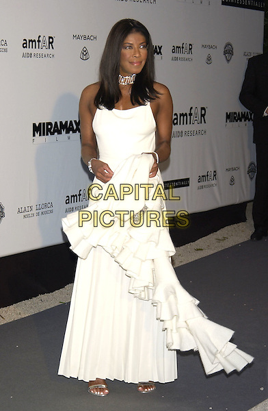 NATALIE COLE<br /> Arrivals at  amfAR 's Cinema Against Aids 2004<br /> at Le Moulin de Mougins,<br /> Cannes Film Festival, <br /> France, 20th May 2004.<br /> full length long white dress silver choker beaded bag <br /> sales@capitalpictures.com<br /> www.capitalpictures.com<br /> &copy;Capital Pictures