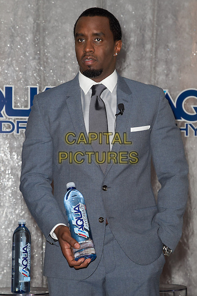 Sean Combs.Press conference to announce their newest venture, Water Brand AQUAhydrate, West Hollywood, California, USA. .February 27th 2013.half length grey gray suit tie shirt  diddy puff daddy goatee facial hair bottle drink beverage  hand in pocket .CAP/ADM/RL.©Rose Lovelle/AdMedia/Capital Pictures.