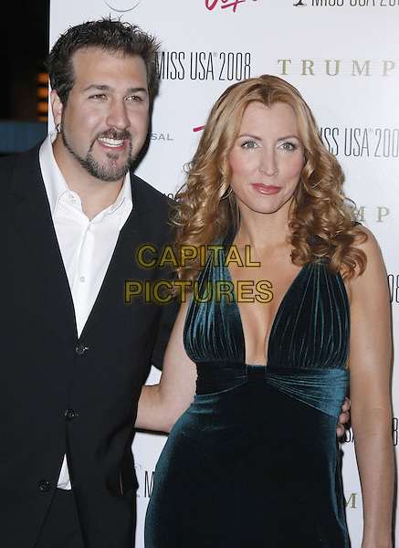HEATHER MILLS & JOEY FATONE ..The 57th Annual Miss USA Competition held at the Planet Hollywood Hotel and Casino, Las Vegas, Nevada, USA, ..11 April 2008...half length black suit jacket beard facial hair green gown dress cleavage ..CAP/ADM/MJT..©MJT/Admedia/Capital Pictures