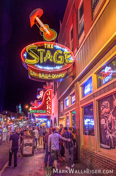 Tourist walk along the bars and honky tonks on lower Broadway in Nashville, Tennessee