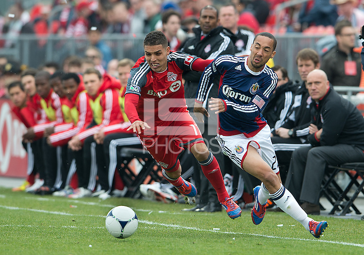 14 April 2012: Toronto FC midfielder Luis Silva #11 and Chivas USA midfielder Ryan Smith #22 in action during a game between Chivas USA and Toronto FC at BMO Field in Toronto..Chivas USA won 1-0.