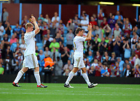 Saturday 15 September 2012<br /> Pictured L-R: Alan Tate and Angel Rangel thanking Swansea supporters at the end of the game. <br /> Re: Barclay's Premier League, Aston Villa v Swansea City FC at Villa Park, West Midlands, UK.