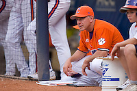 Clemson Tigers head coach Jack Leggett #7 watches the action from the top step of the dugout at Durham Bulls Athletic Park May 22, 2009 in Durham, North Carolina.  (Photo by Brian Westerholt / Four Seam Images)
