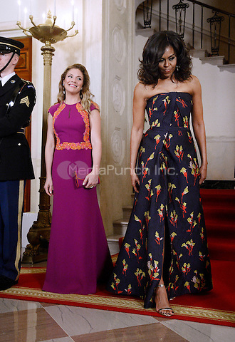 First Lady Michelle Obama, right, and Mrs. Sophie Gr&Egrave;goire Trudeau, left,   walk inside the White House March 10, 2016 in Washington,D.C. <br /> Credit: Olivier Douliery / Pool via CNP/MediaPunch