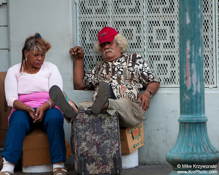 Local Hawaiian couple sleeping during the day outside in Chinatown, Downtown Honolulu, Oahu, Hawaii