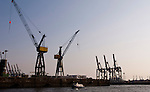 Hamburg-Germany - May 04, 2013 -- Port of Hamburg / harbour at the river Elbe: cranes of different types to (un-)load ships, Infrastructure -- Photo: © HorstWagner.eu