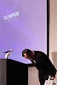 December 15, 2011, Tokyo, Japan - Shuichi Takayama, president of Japans Olympus Corp., bows deeply before speakings during a news conference in Tokyo on Thursday, December 15, 2011. Takayama said the scandal-hit company would aim to hold an extraordinary shareholder meeting in March or April in the wake of demands by foreign investors to overhaul management following the discovery of an accounting fraud. The 92-year-old camera and endoscope maker submitted its overdue revised earnings statement to the Financial Services Agency three hours before the deadline Wednesday to avoid being axed from the Tokyo Stock Exchange. For the April to September quarter, the company booked a net loss of $413 million against a year-earlier profit of $38 million due mainly to one-time losses caused by market deterioration, Thai floods and a decline in the book value of its business assets. Olympus delayed the filing pending the findings of an independent investigation into schemes that used inflated payments for acquisitions to hide about $1.5 billion in losses from the 1990s. (Photo by Natsuki Sakai/AFLO) [3615] -mis-