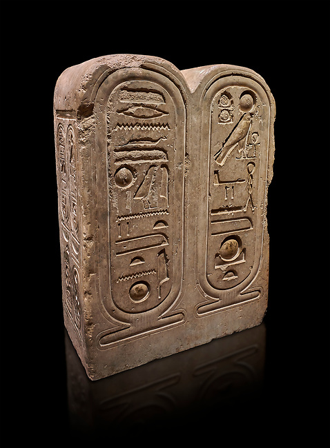 """Ancient Egyptian architectonic element of the temple of Aten, Karnak, limestone, New Kingdom 18th Dynasty (1353-1336 BC). Egyptian Museum, Turin. black background<br /> <br /> This crystaline block from the riugn of Amenhoptep IV was part of the railing of the temple of Aten in Karnak. It is os a double form cartouche, which usually enclose the name of the king. Here insted, it contains the names of the sun disk Aten, the one god of King Akhenaten : """"Ra-Harakhty rising in the Horizon"""" """"in the name as the light which is in Aten"""". The name of the king is carved on the sides. The objects is therefore a links god with the pharoah. Drovetti collection Cat 1378"""