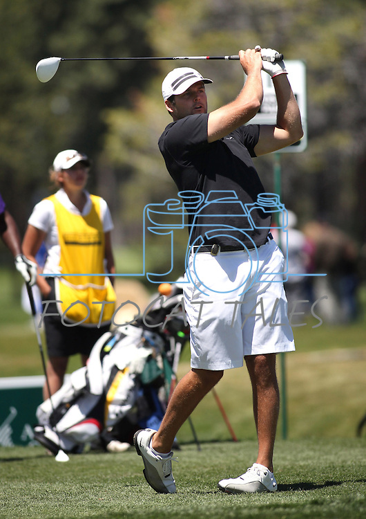 Oakland Raiders quarterback Kyle Boller tees off during a practice round at the 22nd American Century Celebrity Golf Championship at Edgewood Tahoe Golf Course in Stateline, Nev., on Wednesday, July 13, 2011. .Photo by Cathleen Allison