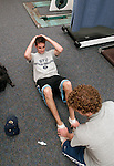 Matt Wagaman (mdw52@email.byu.edu) and Matt Rowan (mjr55@email.byu.edu) do some situps while completing an exersice physiology lab...Aug. 22, 2004.Day in the life of BYU..Photo by Steve Walters/BYU