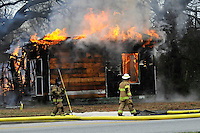 LIVE FIRE TRAINING<br /> Rogers firefighters, including William Hyde, right, deputy chief, conduct a training burn on Saturday Dec. 20 2014 near Eighth and Persimmon streets in Rogers. Firefighters burned a vacant house as the finale of a training exercise, Hyde said. Training at the two-story house started on Thursday, Hyde added.