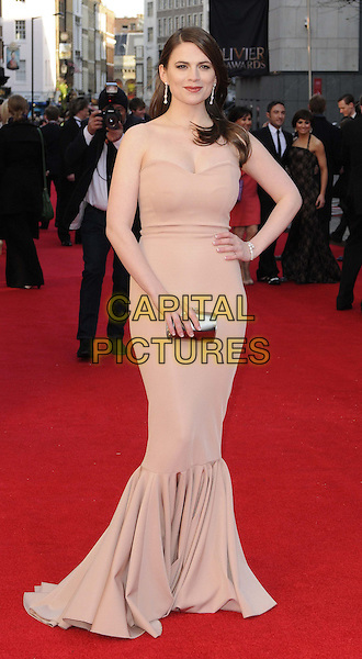 Hayley Atwell.The Olivier Awards 2012, Royal Opera House, Covent Garden, London, England..April 15th, 2012.full length pink beige strapless fishtail dress hand on hip clutch bag silver .CAP/CAN.©Can Nguyen/Capital Pictures.