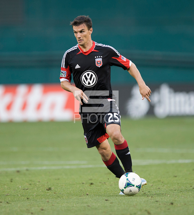Alain Rochat (25) of D.C. United brings the ball forward during a Major League Soccer match at RFK Stadium in Washington, DC. D.C. United lost to the Vancouver Whitecaps, 1-0.