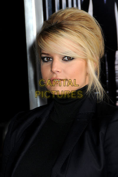 "JESSICA SIMPSON.""Extraordinary Measures"" Los Angeles Premiere held at Grauman's Chinese Theatre, Hollywood, California, USA..January 19th, 2010.headshot portrait black high collar beehive teased hair big sweeping fringe.CAP/ADM/BP.©Byron Purvis/AdMedia/Capital Pictures."