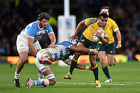 Will Genia of Australia is tackled in possession. Rugby World Cup Semi Final between Argentina v Australia on October 25, 2015 at Twickenham Stadium in London, England. Photo by: Patrick Khachfe / Onside Images