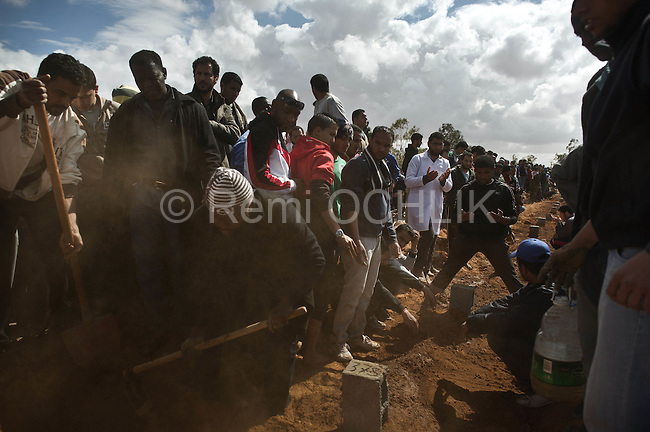 © Remi OCHLIK/IP3 -   Benghazi  March 20, 2011 - Funerals of casulties from bombing in the Harawi cemetery in Benghazi. - At least 84 people, most of them are civilians , and had been killed in the Ghadafi air strike the day before.