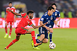 Doan Ritsu of Japan (R) is challenged by Raed Saleh of Oman (L) during the AFC Asian Cup UAE 2019 Group F match between Oman (OMA) and Japan (JPN) at Zayed Sports City Stadium on 13 January 2019 in Abu Dhabi, United Arab Emirates. Photo by Marcio Rodrigo Machado / Power Sport Images