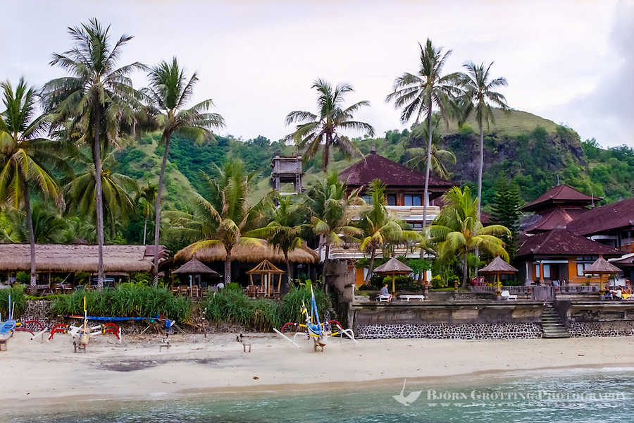 Bali, Karangasem, Candidasa. The beach looking west.
