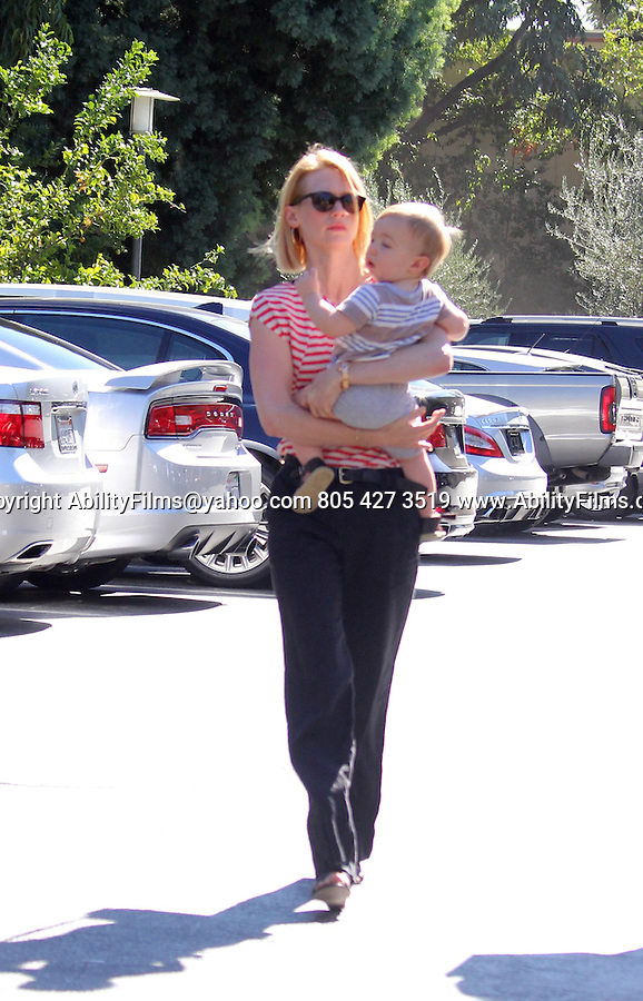 Novemeber 5th 2012 <br /> <br /> January Jones leaving Houstons restaurant in Pasadena California holding her baby Xander. Walking with her mom wearing red white stripped shirt black pants <br /> <br /> <br /> AbilityFilms@yahoo.com<br /> 805 427 3519<br /> www.AbilityFilms.com