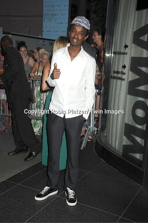 "K' Naan attends the New York Premiere of ""Cosmopolis"" on .August 13, 2012 at MoMA in New York City. The premiere was presented by Gucci and The Peggy Siegal Company. .The stars of the movie are Robert Pattinson, Paul Giamatti, Sarah Gadon, Kevin  Durand and Emily Hampshire."