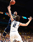 SAN ANTONIO, TX - APRIL 02: Charles Matthews #1 of the Michigan Wolverines shots the ball over Collin Gillespie #2 of the Villanova Wildcats during the second half of the 2018 NCAA Men's Final Four National Championship game at the Alamodome on April 2, 2018 in San Antonio, Texas.  (Photo by Brett Wilhelm/NCAA Photos via Getty Images)